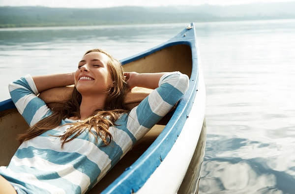 Girl on boat with piece of mind with Employee Benefits Life Insurance